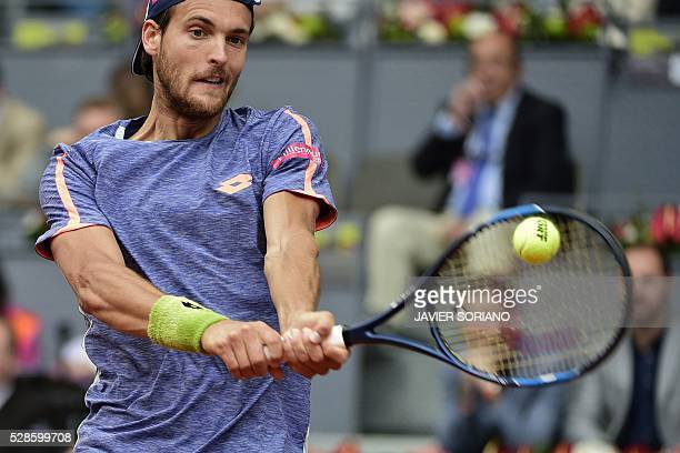 Portuguese tennis player Joao Sousa returns a ball to Spanish tennis player Rafael Nadal during the Madrid Open tournament at the Caja Magica sports...