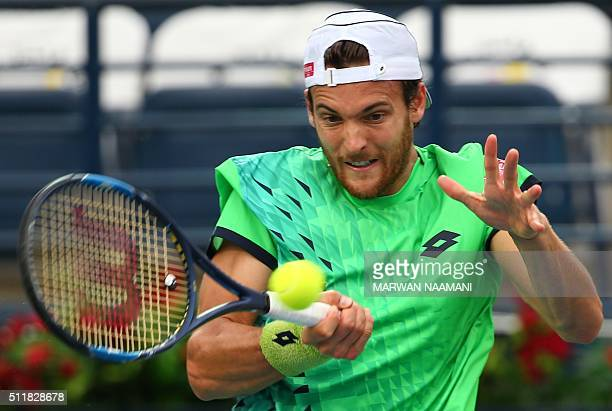 Portuguese tennis player Joao Sousa returns the ball to Czech player Tomas Berdych during their ATP tennis match on the second round of the Dubai...