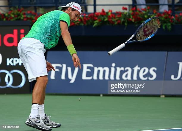 Portuguese tennis player Joao Sousa throws his raquet after losing a point to Czech player Tomas Berdych during their ATP tennis match on the second...