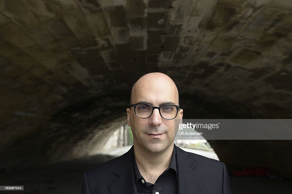 PARIS, FRANCE - SEPTEMBER 30. Portuguese writer Valter Hugo Mae poses during a portrait session on September 30, 2013 in Paris, France.