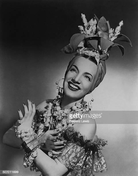 PortugueseBrazilian singer dancer and actress Carmen Miranda in one of her trademark outfits circa 1940