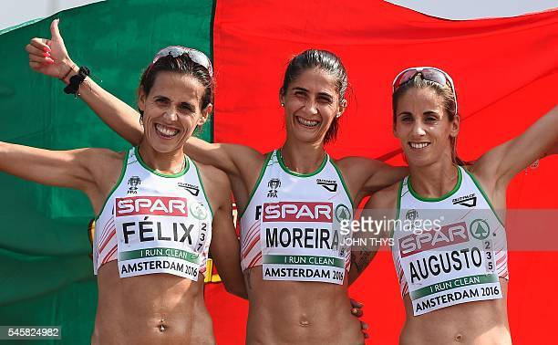 Portugueses athletes Felix Dulce Sara Moreira and Jessica Augusto pose after crossing the finish line in the Women's semi marathon final race during...