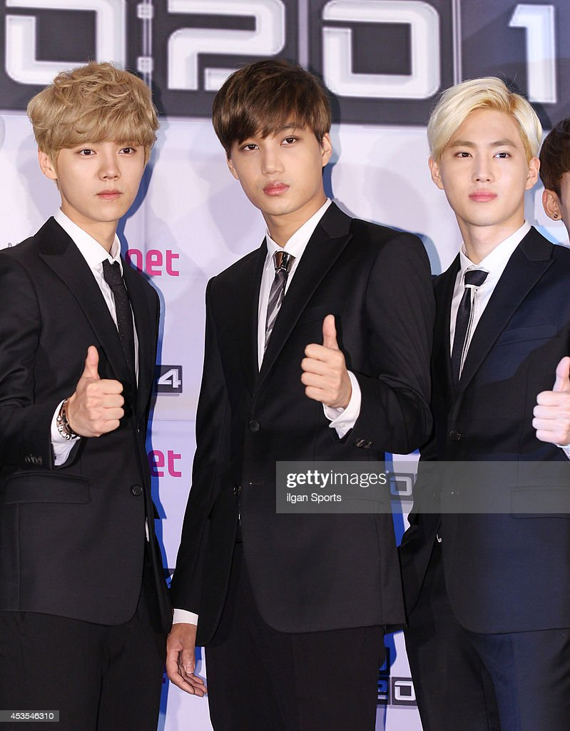 EXO pose for photographs during the Mnet 'EXO 902014' press conference at CJ EM center on August 11 2014 in Seoul South Korea
