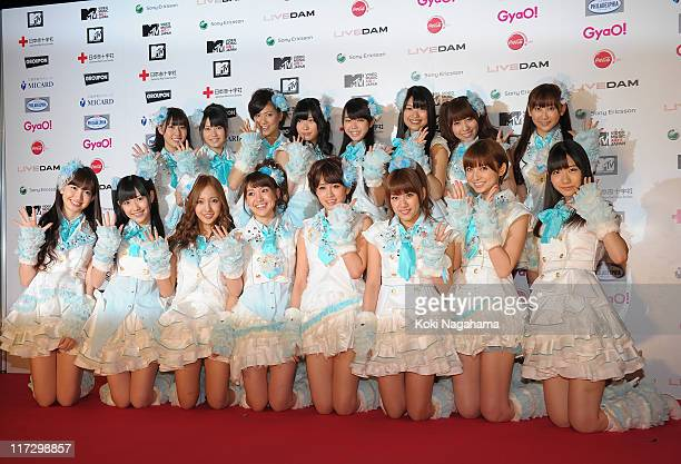 AKB48 pose for photographs on the red carpet during the MTV Video Music Aid Japan at Makuhari Messe on June 25 2011 in Chiba Japan