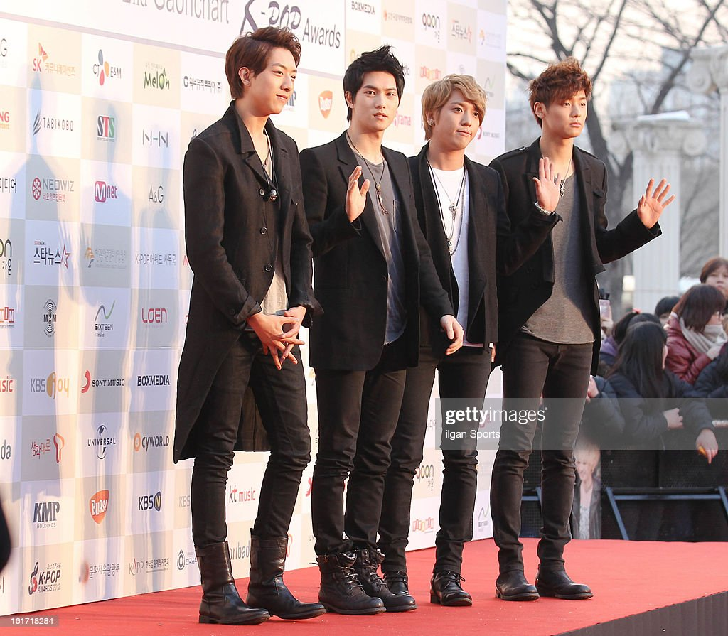 CNBLUE pose for photographs upon arrival during '2nd Gaonchart K-pop Awards' at Olympic Hall on February 13, 2013 in Seoul, South Korea.