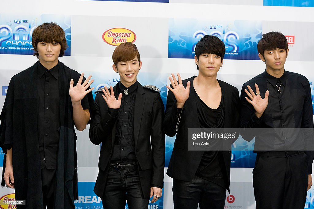 <a gi-track='captionPersonalityLinkClicked' href=/galleries/search?phrase=2AM&family=editorial&specificpeople=1480869 ng-click='$event.stopPropagation()'>2AM</a> pose for photographs upon arrival during the 2010 Mnet 20's Choice at Sheraton Grande Walkerhill Hotel on August 26, 2010 in Seoul, South Korea.