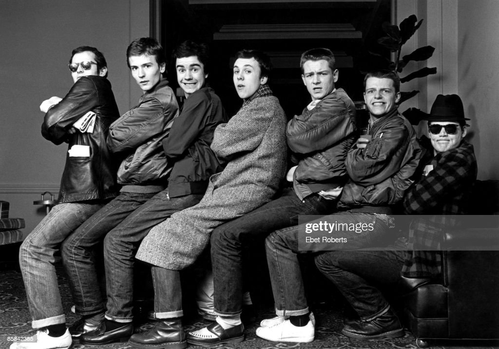 Photo of MADNESS; Posed group portrait - Lee Thompson, Dan 'Woody' Woodgate, Chris Foreman, Mark Bedford, Chas Smash, Suggs, Mike Barson
