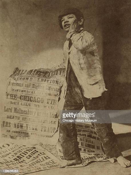 Posed image of a newsboy crying out the news of the Great Chicago Fire Chicago Illinois 1871