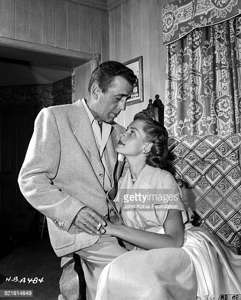 Posed portrait of actors and spouses Humphrey Bogart and Lauren Bacall in their home for Warner Bros Studios 1945