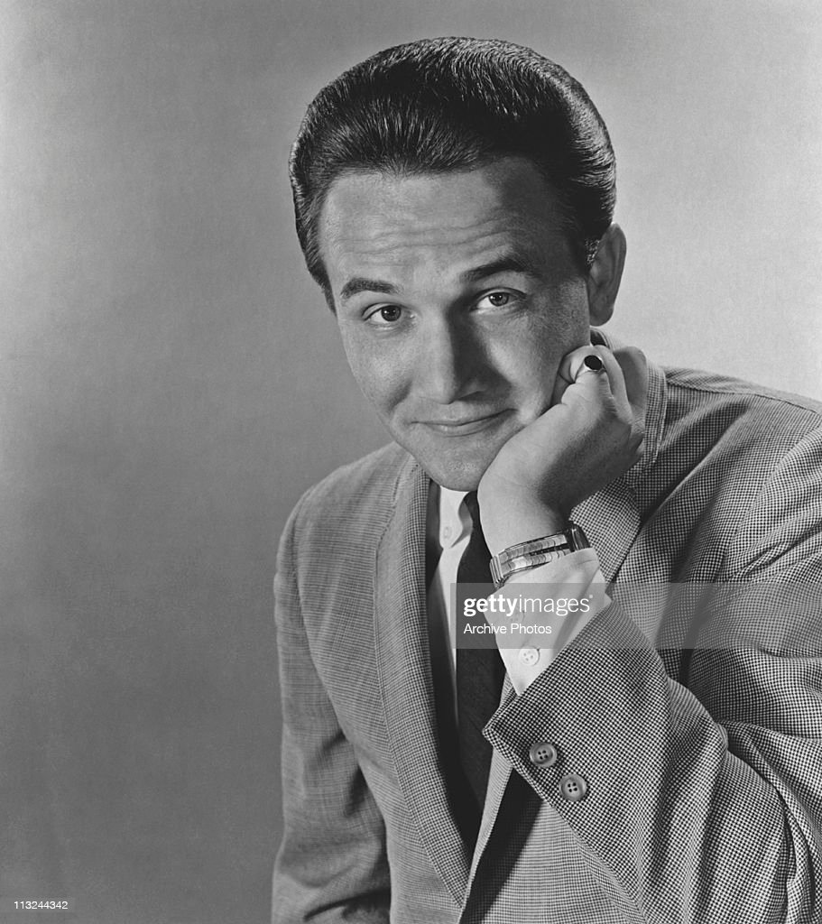 Posed portrait of American country singer Roger Miller circa 1966