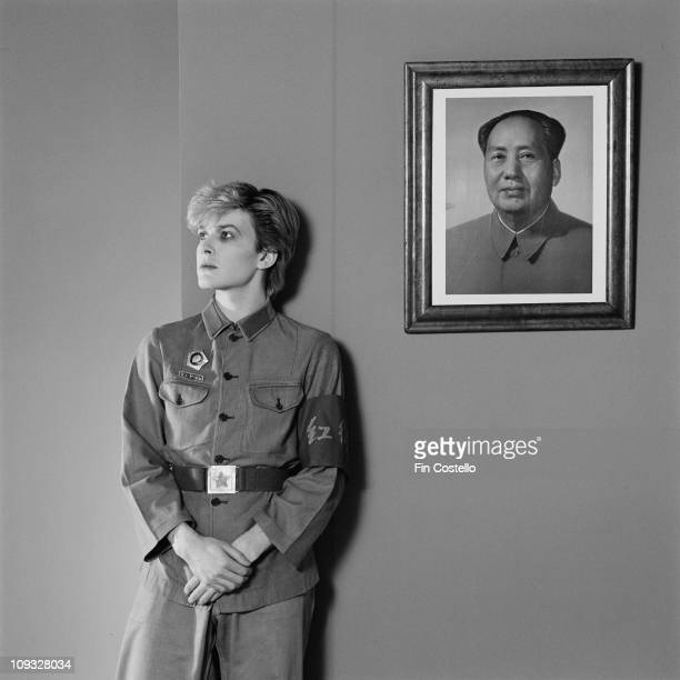Posed portrait of David Sylvian from Japan during the Tin Drum album photo session in November 1981 A picture of Chairman Mao hangs behind