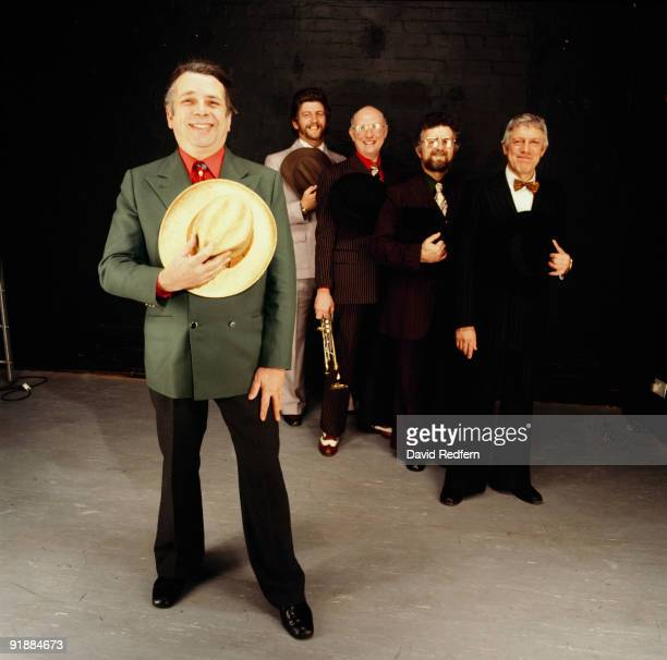 Posed portrait of jazz singer and writer George Melly with John Chilton's Feetwarmers in 1978