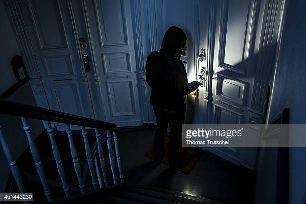 Posed scene of a man breaking into an apartment on June 27 in Berlin Germany The photo symbolizes the increasing risk of burglary in Germany