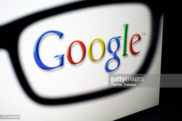 Posed scene on the topic google glasses in front of the google company logo on April 21 2015 in Berlin Germany Photo by Thomas Trutschel/Photothek...