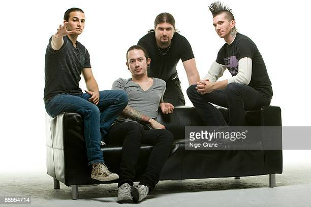 Posed studio group portrait of American heavy metal band Trivium Left to right are Paolo Gregoletto Matt Heafy Corey Beaulieu and Travis Smith in...