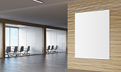 Large vertical poster hanging on wooden wall in corridor with two conference rooms. 3d rendering. Mock up