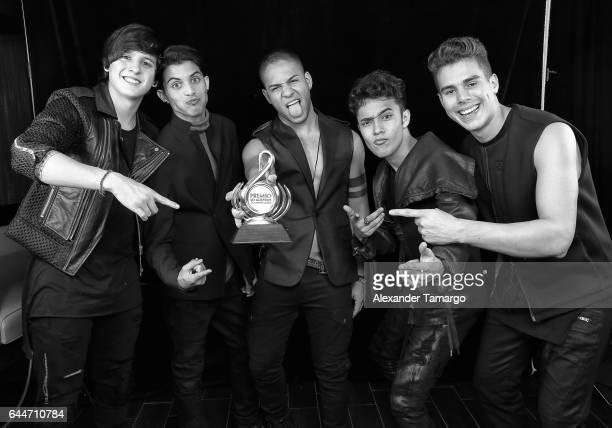 CNCO poses at Univision's 29th Edition of Premio Lo Nuestro A La Musica Latina at the American Airlines Arena on February 23 2017 in Miami Florida