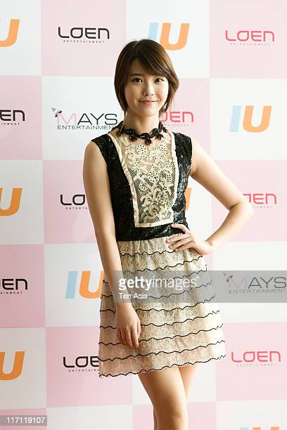 IU poses for photographs before the fan meeting at AXKOREA in June 18 2011 in Seoul South Korea