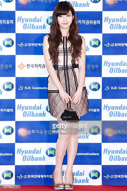 IU poses for photographs upon arrival during the '2011 Dream Concert' at Seoul World Cup Stadium on May 28 2011 in Seoul South Korea