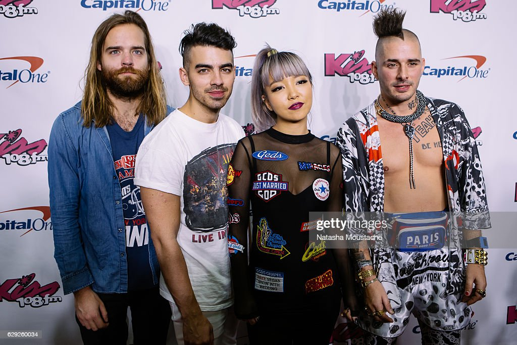 DNCE poses on the red carpet at TD Banknorth Garden on December 11, 2016 in Boston, Massachusetts.