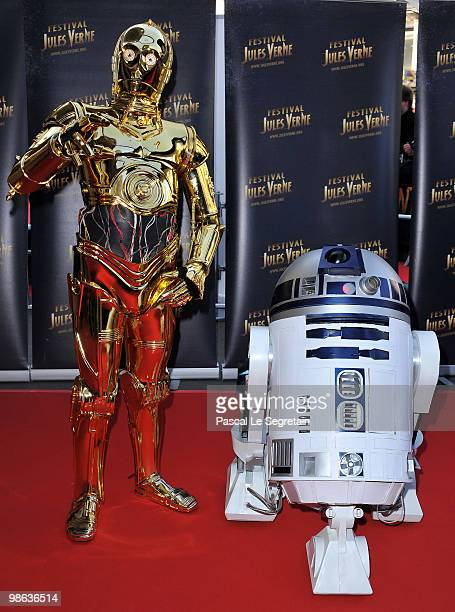C3PO poses with R2D2 during the 18th Adventure Film Festival at Le Grand Rex on April 23 2010 in Paris France