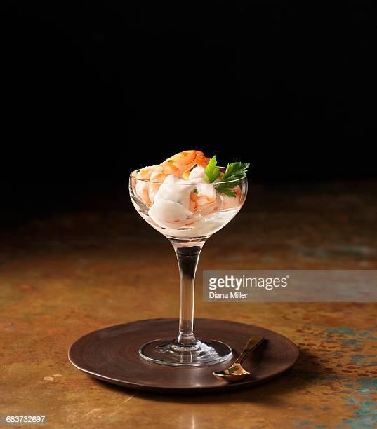 Posh prawn cocktail in wine glass with coriander