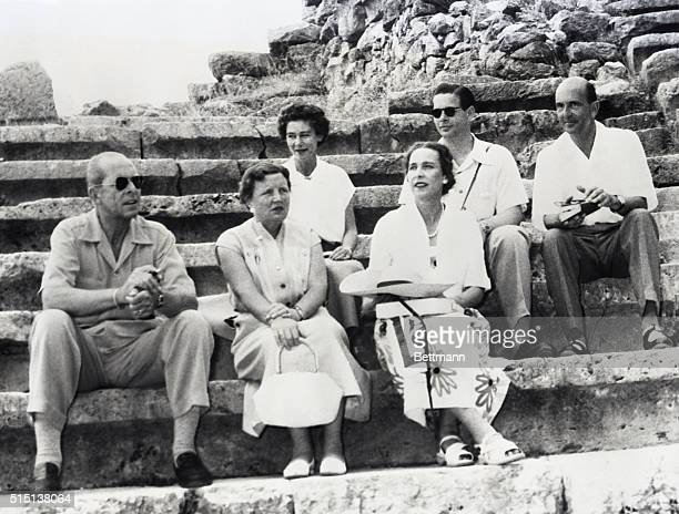Posing at the Delphi Amphitheatre during the Royal cruise guided by the King and Queen of Greece are host and hostess and four of the guests In front...