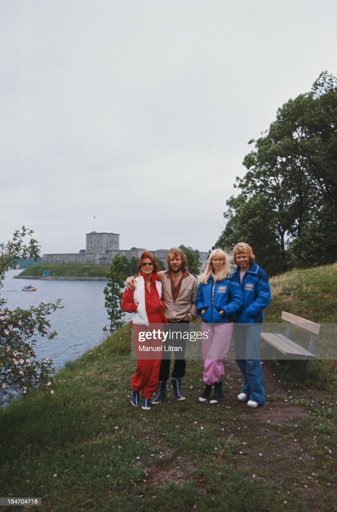ABBA posing at the waterfront in the open air with Anni-Frid Lyngstad (Frida called) and her husband Benny Andersson, Agnetha Faltskog and Bjorn Ulvaeus her husband (in blue).