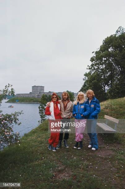 ABBA posing at the waterfront in the open air with AnniFrid Lyngstad and her husband Benny Andersson Agnetha Faltskog and Bjorn Ulvaeus her husband