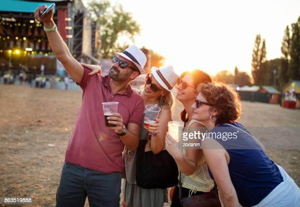 Posing for selfie at music festival