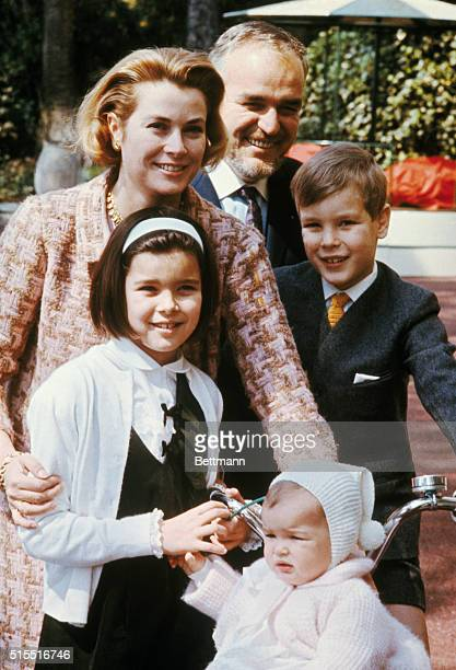 Posing in the Garden of their palace Prince Rainier and Princess Grace who will mark their 10th wedding anniversary April 18 are shown with their...