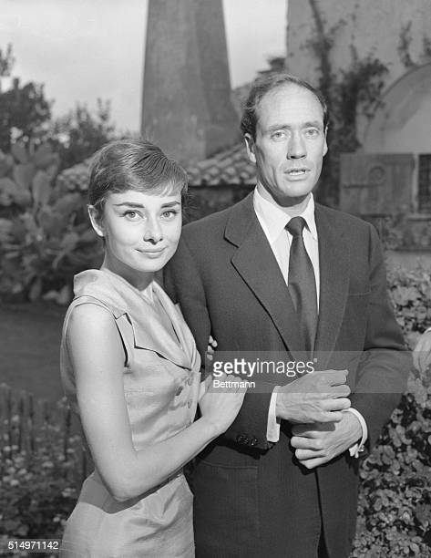 Posing together in the garden of their honeymoon villa Audrey Hepburn petite Academy Award winner in the film Roman Holiday and her actor husband Mel...