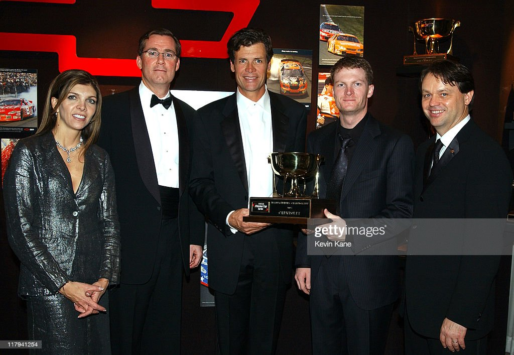 Posing with the 2003 Chevrolet Manufacturer's Championship trophy are DEI and car owner Teresa Earnhardt Exc Director General Motors Marketing...