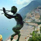 Positano, Amalfi Coast, with faun playing flutes