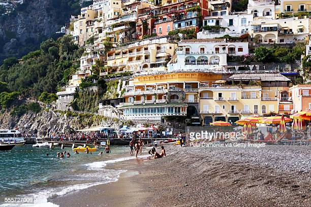 Positano beach scene and houses at background, It