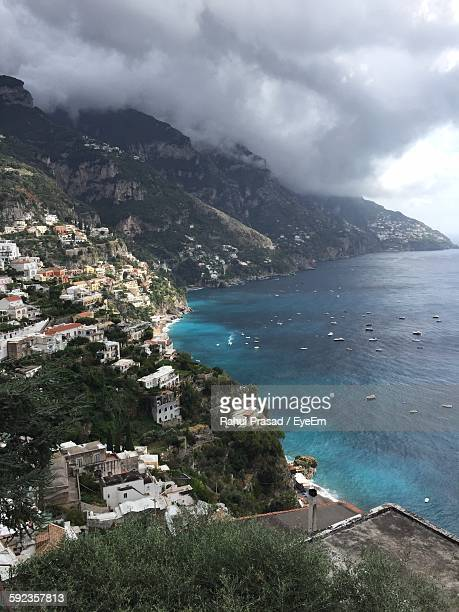 Positano By Sea Against Cloudy Sky