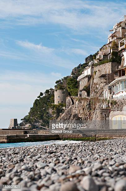 Positano's pebbled shore and Saracen Towers