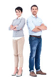 Two experienced and confident businesspeople crossing their arms while isolated on white