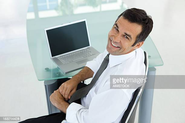 Positive businessman at workplace