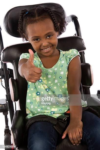 Positive little girl in wheelchair
