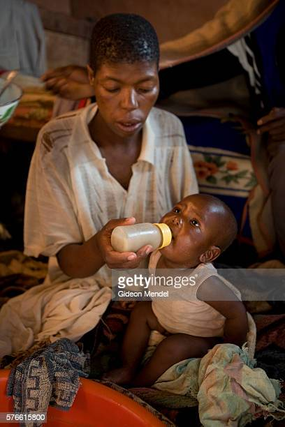 HIV positive Matiesetso Pahlabaki makes the mistake of bottle feeding her eightmonth old baby girl Retsipele with a basic porridge in her home in the...