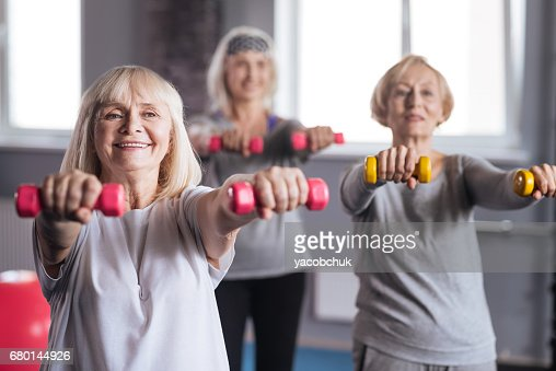 Positive persistent women trying to lose some weight : Stock Photo
