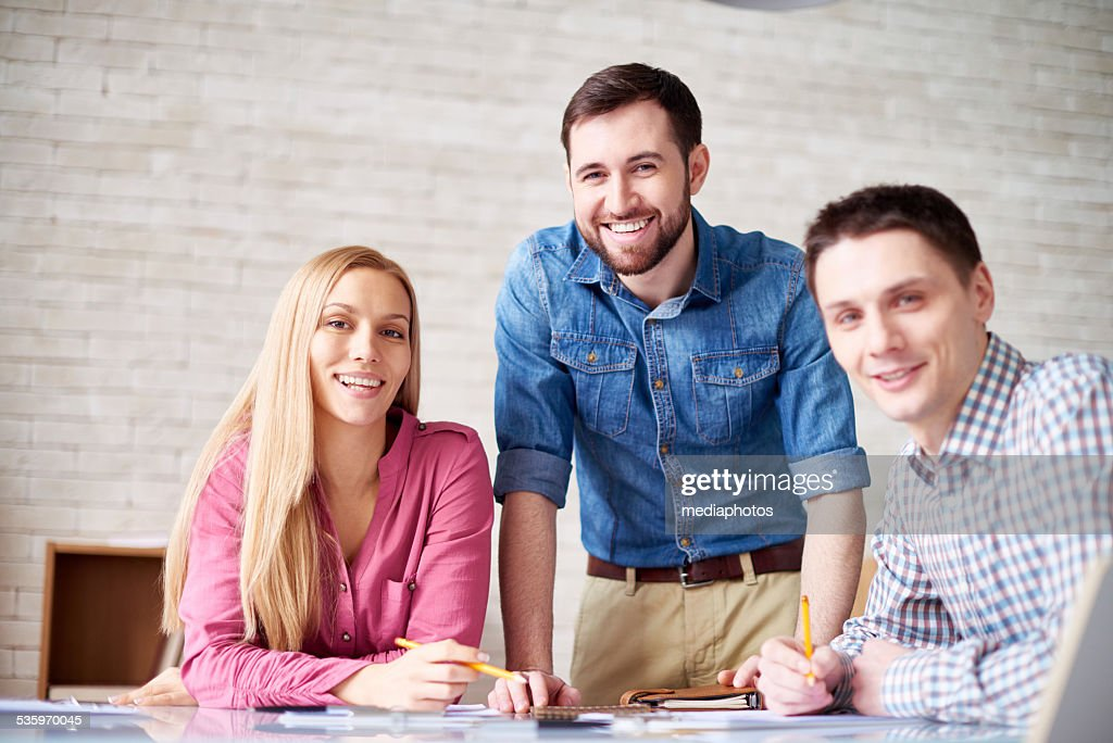 Positive young team : Stock Photo