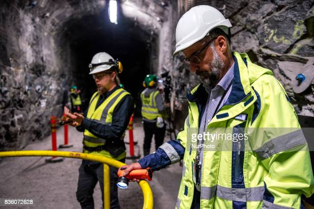 Posiva geologist Tuomas Pere and Head of Communications of Teollisuuden Voima Pasi Tuohimaa in a demonstration tunnel approximately 420 meters...