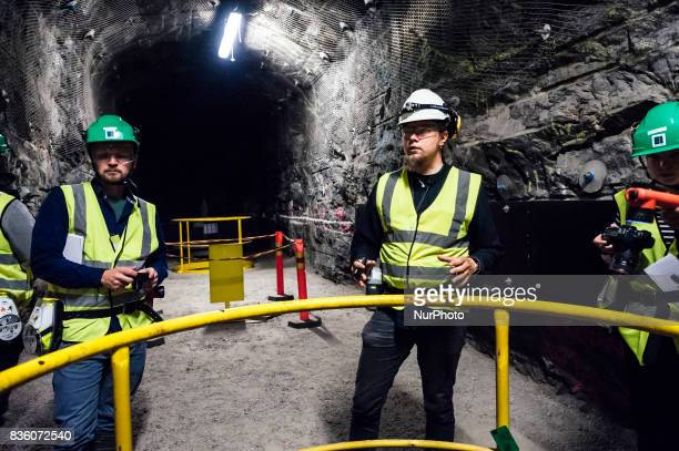 Posiva geologist Tuomas Pere and media representatives in a demonstration tunnel approximately 420 meters underground at Posiva's spent nuclear fuel...