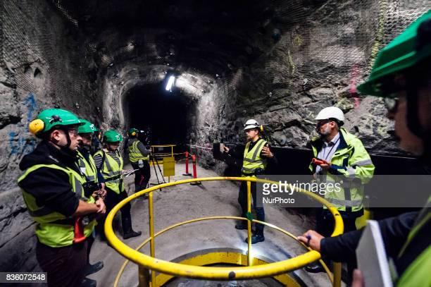 Posiva geologist Tuomas Pere Head of Communications of Teollisuuden Voima Pasi Tuohimaa and media representatives in a demonstration tunnel...