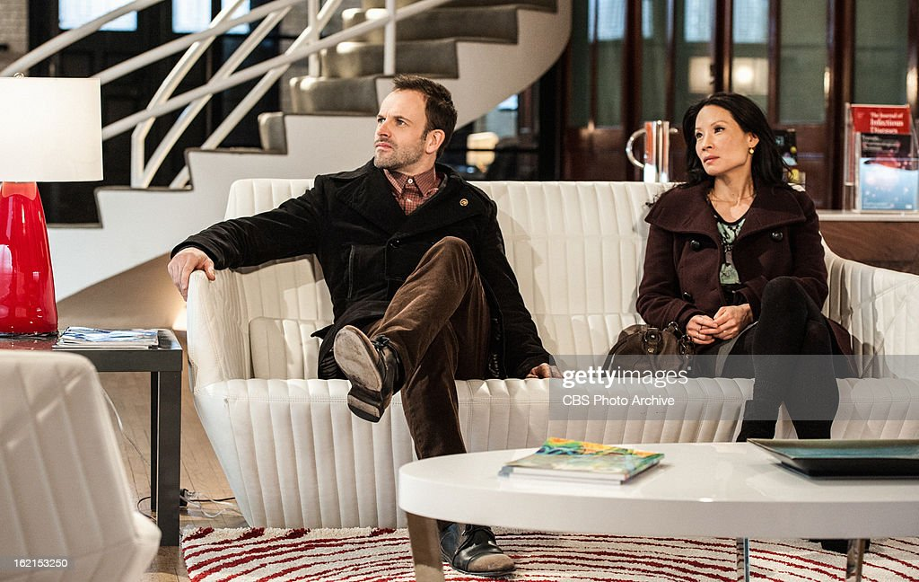 'Possibility Two' -- Sherlock (Jonny Lee Miller) tries to teach Joan (Lucy Liu) his deductive skills by sending her to a suspicious dry cleaning establishment, on ELEMENTARY, on a Thursday, Feb. 21 on the CBS Television Network.