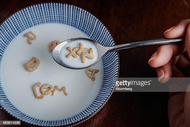 Post Foods LLC AlphaBits cereal letters spell out 'XYZ' on a spoon and 'COM' in a bowl in this arranged photograph taken in New York US on Wednesday...