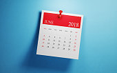 Post it June calendar on blue background. Horizontal composition with copy space. Calendar and reminder concept.