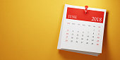 Post it June calendar on yellow background. Panoramic composition with copy space. Calendar and reminder concept.